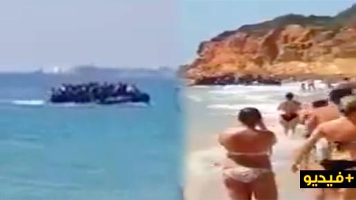شاهدوا بالفيديو.. قارب للهجرة السرية على متنه العشرات من المهاجرين يفاجئ المصطافين بشاطئ إسباني