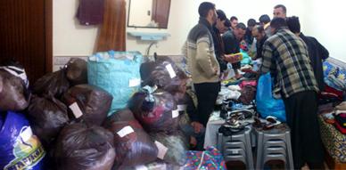 توزيع مجموعة من الملابس على المحتاجين بقرية إشنيون