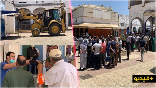 السلطات تستعين بجرافة لإزالة واقيات المحلات التجارية في أول يوم لإعادة فتح سوق المركب