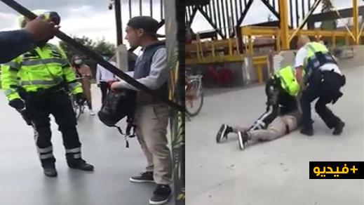 شرطي بلجيكي يضرب مهاجرا ويسقطه أرضا لرفضه وضع الكمامة في فضاء عامّ