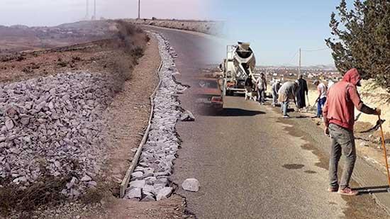 أشغال إصلاح جنبات الطريق الرابطة بين جماعة أمجاو ودار الكبداني