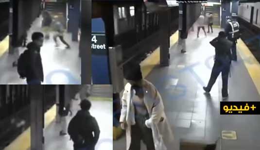 """شاهدوا.. شاب """"متهور"""" يدفع امرأة تحت عجلات قطار متحرك"""
