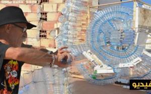 """فنان تشكيلي يستغل نفايات وقنينات الماء لتجسيد معلمة """"كلوب"""" بالناظور"""